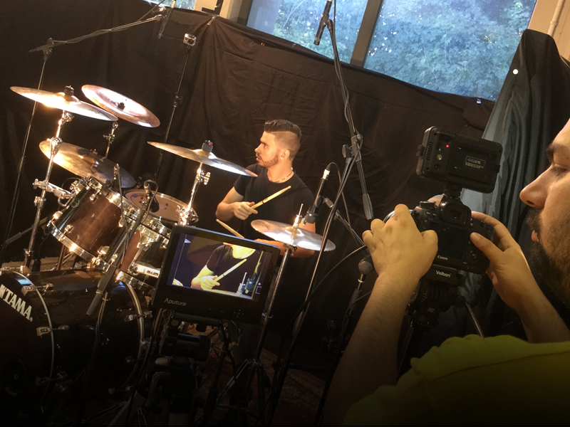 Angelo De Santi during the filming of his drum tech videos